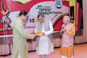 Abdullah Abu Sayeed receives the Muktadhhara-GFB Literary Award at NY Bangla Boimela 2018